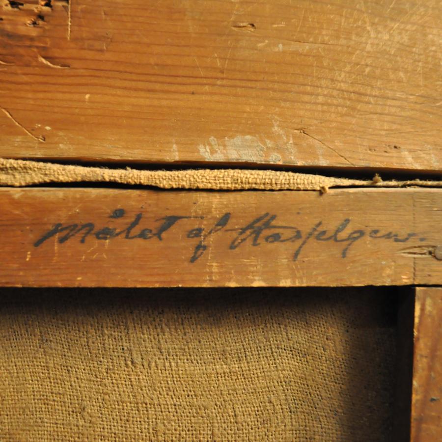 Signeringen på tavlans baksida.